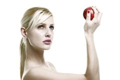 Beauty lady and apple. Apple on the hand of blond stock photography