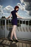 Beauty lady posing on floodgate Stock Photo