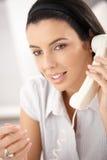 Beauty on landline call Stock Photos