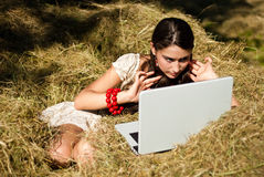 Beauty and laptop in the village. Royalty Free Stock Image