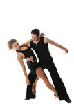 Beauty latin dancing. The young man and the girl dancing the Latin American dance Royalty Free Stock Image
