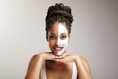 Beauty latin woman with a half of a face mask Stock Image