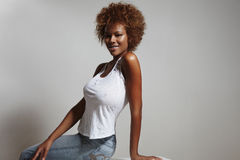 Beauty latin woman wearing jeans and white top Royalty Free Stock Photos