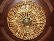 Chandelier light crystal gold sparkling Stock Images