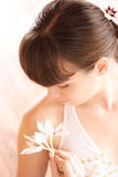 Beauty like the flowers. Young girl with flowers on her skin Stock Images