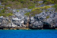 Beauty limestone rock in the ocean Stock Photos