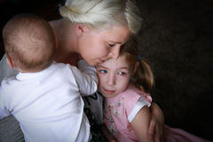 Beauty little boy with mother. Little girl with sick eye with conjunctivitis Royalty Free Stock Photography