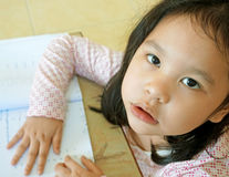 Beauty little girl with homework Royalty Free Stock Photo
