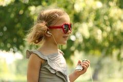 Beauty little girl listening music Royalty Free Stock Image