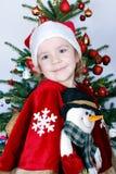 Beauty little girl Santa Claus Stock Photos