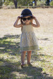Beauty little girl with sunglasses and a hat. In the park Stock Photography