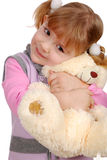 Beauty little girl with teddy-bear Stock Photo
