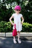 Beauty little girl in white dress posing ourdoors Stock Photo