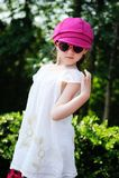 Beauty little girl in white dress posing ourdoors Stock Images