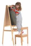 Beauty a little girl writing Stock Image