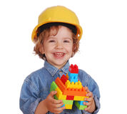 Beauty little girl with yellow helmet Stock Photos