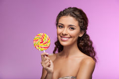 Beauty with lollipop. Beautiful young women holding a lollipop w Stock Photo