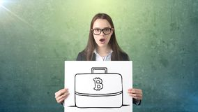 Beauty business woman standing near btc logo. Succesful Bitcoin investment. Concept of virtual criptocurrency. stock photography