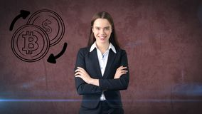 Beauty business woman standing near btc logo. Succesful Bitcoin investment. Concept of virtual criptocurrency. Beauty longhair business woman in suit standing Royalty Free Stock Images