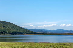 Beauty look toward picturesque Rabisha  lake and mountain over Magura cave Royalty Free Stock Photo
