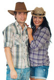 Beauty loving couple in cowboy's hat Royalty Free Stock Photography