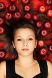 Beauty lying on apples Royalty Free Stock Photo