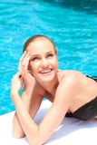 Beauty lying next to swimming pool Stock Image