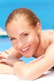 Beauty lying next to swimming pool Royalty Free Stock Image