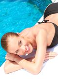 Beauty lying next to swimming pool Stock Images