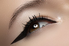 Beauty macro of eye with fashion liner make-up Stock Image