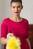 Beauty maid with feather duster Royalty Free Stock Photography