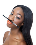 Beauty with a make up brush. Portrait of an young African beauty with a make up brush Royalty Free Stock Photo