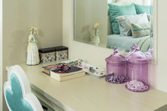 Beauty and make-up set on a dressing table. Beauty and make-up concept: mirror,jewelry and makeup set on a dressing table royalty free stock photo