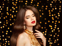 Beauty Makeup. Beautiful brunette girl with long wavy hairstyle. Stock Image