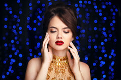 Beauty Makeup. Beautiful elegant woman in fashion golden dress. Royalty Free Stock Image