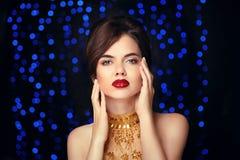 Beauty Makeup. Beautiful elegant woman in fashion golden dress. Stock Images