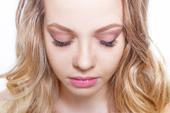 Beauty makeup for blue eyes. Beautiful face closeup. Perfect skin, long eyelashes, make up concept. Royalty Free Stock Photos