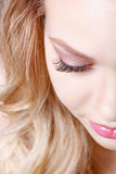 Beauty makeup for blue eyes. Part of beautiful face closeup. Perfect skin, long eyelashes, make up concept. Stock Photos