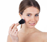Beauty with makeup brush Stock Photography