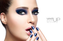 Beauty and Makeup concept. With Beautiful young woman with hands on her face covering mouth. Perfect skin. Trendy nail art and makeup. Close up Portrait Royalty Free Stock Photos