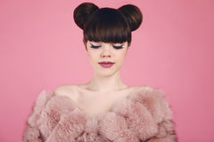 Beauty makeup. Fashion teen girl model in fur coat. Brunette wit Royalty Free Stock Photography