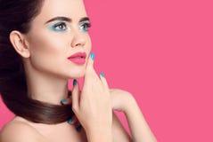 Beauty makeup. Fashion women closeup portrait. Blue manicured na. Beauty makeup. Fashion woman closeup portrait. Blue manicured nails. Glamour young brunette Stock Image