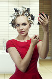 Beauty makeup girl with hair rollers Royalty Free Stock Photos