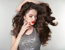 Beauty Makeup. Healthy Long Hair. Beautiful brunette girl with b Stock Photos