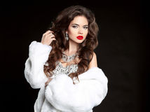 Beauty Makeup. Long hair. Beautiful Woman in Luxury white mink F Royalty Free Stock Photos