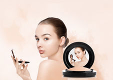 Beauty makeup model holding powder foundation Royalty Free Stock Images