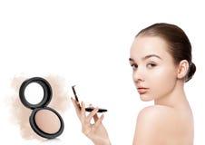 Beauty makeup model holding powder foundation Royalty Free Stock Photo