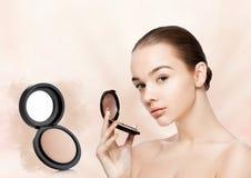 Beauty makeup model holding powder foundation Royalty Free Stock Image