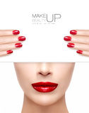 Beauty Makeup and Nail Art Concept. Beautiful fashion model woman with trendy red lipstick to match her manicured nails, half face with a white card template Stock Photography