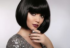 Beauty Makeup, Silver Manicured polish nails. Bob hairstyle. Fashion Style Brunette Woman Portrait with black Short Hair and. Glitter lips isolated on gray stock images